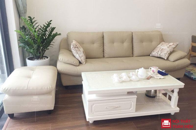 ghế sofa văng da màu sáng thít nút phòng khách chung cư nhỏ